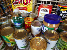 FOOD PANTRY: Food sits in a shopping cart after it was pulled from shelves  in the Patriot Pantry. It is a portion of  food  that will be given to students in need at Putnam City West High School. Wednesday, Sep. 14, 2011.   Photo by Jim Beckel, The Oklahoman  ORG XMIT: KOD